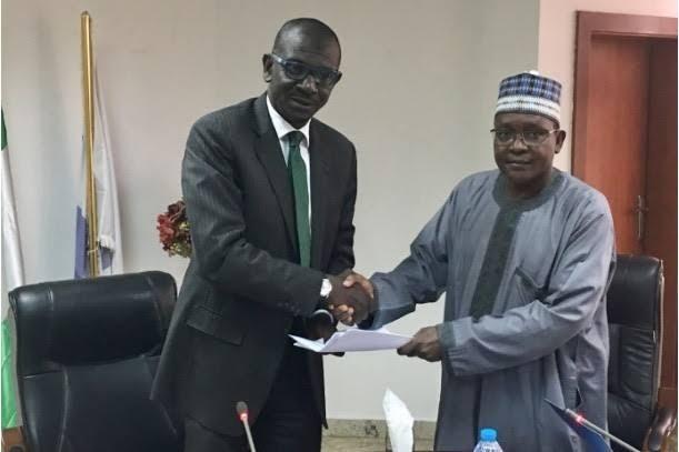 Front left: NEXIM Bank CEO Abubakar Abba Bello and former Acting MD Bashir Wali at the NEXIM Bank headquarters during the ceremonial handover