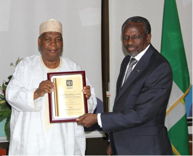 L-R: NDIC MD/CEO, Alhaji Umaru Ibrahim, receiving an award from the President, Institute of Directors (IOD) Governing Council, Alhaji Ahmed Rufai