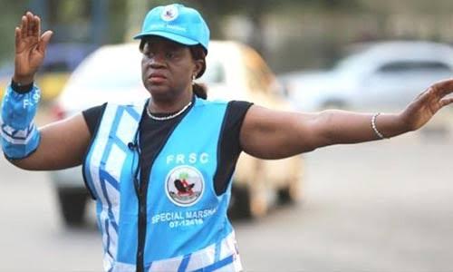 Justice Monica Dongban-Mensem controlling Traffic in Abuja